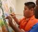 Young muralist Jorge Mario Abundis